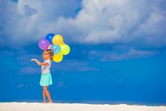 Adorable little girl playing with balloons at the Stock Image