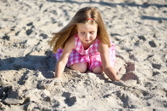 Adorable little girl playing on beach. On summer day Royalty Free Stock Photos