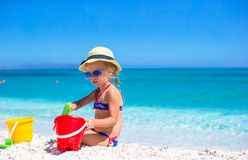 Adorable little girl playing with beach toys Stock Photos