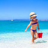 Adorable little girl playing with beach toys Stock Images