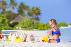 Adorable little girl playing with beach toys. During summer vacation Stock Photo