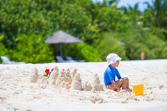 Adorable little girl playing with beach toys Royalty Free Stock Photos