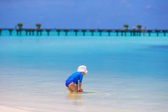 Adorable little girl playing with beach toys. During summer vacation Royalty Free Stock Photography