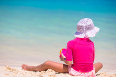 Adorable little girl playing with beach toys. During summer vacation Royalty Free Stock Photo
