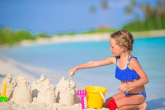 Adorable little girl playing with beach toys Royalty Free Stock Images