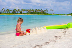 Adorable little girl playing with beach toys. During summer vacation Stock Photography