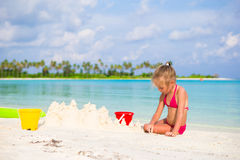 Adorable little girl playing with beach toys. During summer vacation Royalty Free Stock Photos