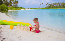Adorable little girl playing with beach toys. During summer vacation Royalty Free Stock Images