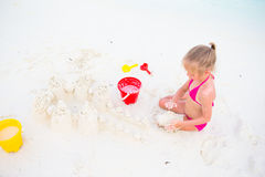 Adorable little girl playing with beach toys. During summer vacation Stock Image