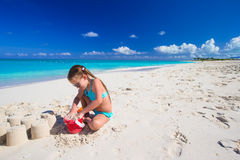 Adorable little girl playing with beach toys Stock Photography