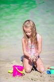 Adorable little girl playing with beach toys. Little girl playing with beach toys during tropical vacation Royalty Free Stock Photography