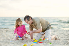 Adorable little girl playing on a beach Stock Images