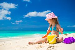 Adorable little girl playing on the beach with white sand. Adorable girl playing on the beach with white sand Royalty Free Stock Photos