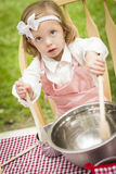Adorable Little Girl Playing Chef Cooking Stock Photos