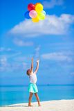 Adorable little girl playing with colorful Stock Photography