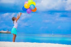 Adorable little girl playing with colorful Royalty Free Stock Photos