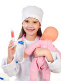 Adorable little girl playing at the doctor Stock Photo