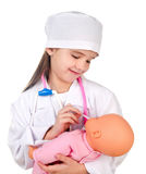 Adorable little girl playing at the doctor Royalty Free Stock Image