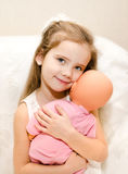 Adorable little girl playing with a doll Stock Photography