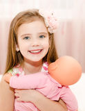 Adorable little girl playing with a doll Royalty Free Stock Photos