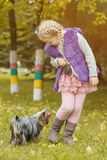 Adorable little girl playing with her puppy Stock Photography