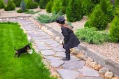 Adorable little girl playing with her puppy outdoor Royalty Free Stock Photo