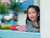 Adorable little girl playing peekaboo Stock Images