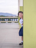 Adorable little girl playing peekaboo Royalty Free Stock Photo