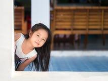 Adorable little girl playing peekaboo Royalty Free Stock Image