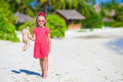 Adorable little girl playing with plush toy on Royalty Free Stock Photo