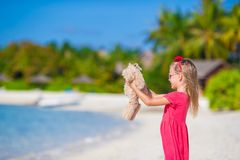 Adorable little girl playing with plush toy on Stock Image