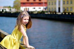 Adorable little girl playing by a river on a beautiful summer day stock photography