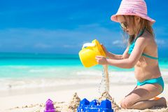 Adorable little girl playing with sand on a Stock Photography