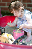 Adorable little girl playing in a sandbox Royalty Free Stock Photography