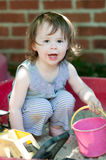 Adorable little girl playing in a sandbox Royalty Free Stock Image