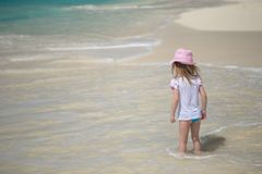 Adorable little girl playing in shallow water at Royalty Free Stock Photography