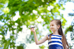 Adorable little girl playing with small toy airplane outdoors Royalty Free Stock Image