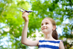 Adorable little girl playing with small toy airplane outdoors Stock Image