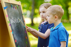 Adorable little girl playing a teacher Royalty Free Stock Photography