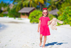 Adorable little girl playing with toy during beach Royalty Free Stock Image