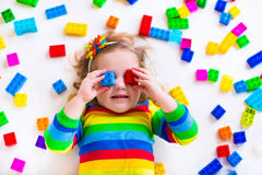 Adorable little girl playing with toy blocks Royalty Free Stock Images
