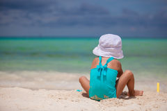 Adorable little girl playing at tropical beach Stock Image