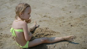 Adorable little girl playing on white sand beach. Adorable little blonde girl playing on white sand beach stock video