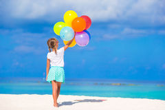 Free Adorable Little Girl Playing With Balloons At The Stock Photography - 53404422