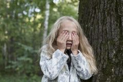 Adorable little girl playing in the wood Stock Photography