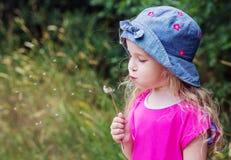 Adorable little girl plays Royalty Free Stock Photos