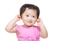 Adorable little girl plugs her ears Stock Photos
