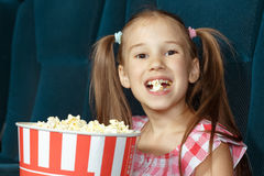 Adorable little girl with popcorn Royalty Free Stock Photos