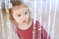 Adorable little girl portrait indoors Stock Photos