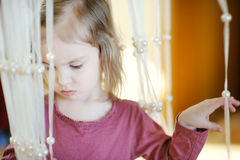 Adorable little girl portrait indoors Stock Images